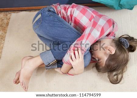 Teen girl frustration crying lying on the floor - stock photo