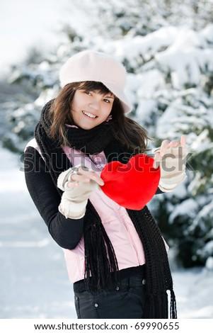 Teen girl heart in his hands - stock photo