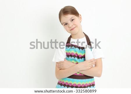 Teen girl holding a milk bottle - stock photo