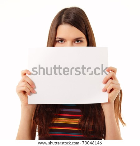 teen girl holding blank white paper closeup isolated on white background - stock photo