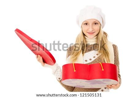 teen girl holding heart shaped box - stock photo
