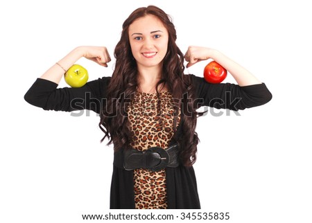 Teen girl holding two apple on her biceps. Isolated on white. - stock photo