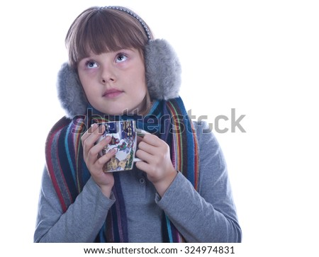Teen girl in grey warm headphones with Christmas decorated cup in hands drinks tea isolated white dreaming portait - stock photo