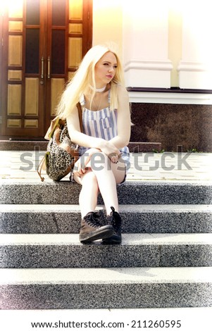 teen girl in gym shoes and a backpack - stock photo