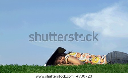 Teen girl in outdoor study with a laptop