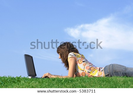 Teen girl in outdoor study with a laptop - stock photo