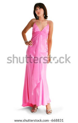 Teen Girl In Pink Formal Dress. Shot in studio over white. - stock photo