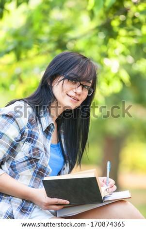 Teen girl in the park. - stock photo