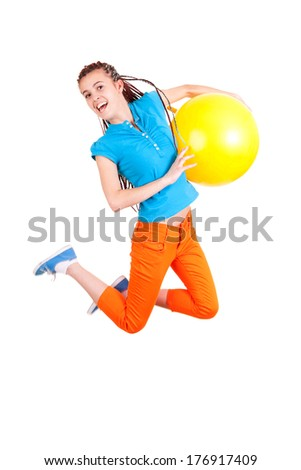 Teen girl jumping with ball white background