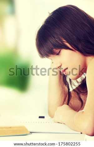 Teen girl learning at the desk  - stock photo