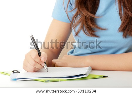 Teen girl learning at the desk, isolated on white - stock photo