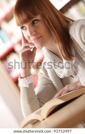 Teen girl learning at the desk, looking up - stock photo