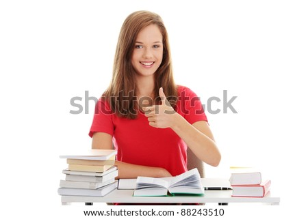 Teen girl learning - thumbs up, isolated on white background