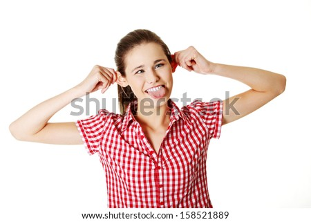 Teen girl making a face to the camera, on white - stock photo