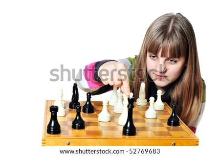 teen girl making  checkmate playing chess, she is winner - stock photo