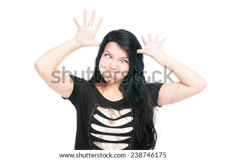Teen girl making funny face with crossed eyes - stock photo