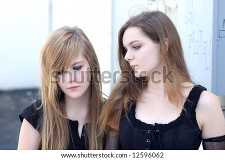 Teen girl models in goth or emo outfits with emotional expressions
