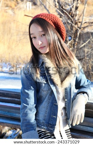 Teen girl outside on a cold winters day - stock photo