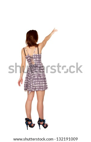 Teen girl pointing at something. Rear view. Isolated on white background - stock photo