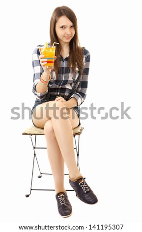 Teen Girl Relaxing Sitting On The Folding Chair With A Cocktail In Hand.  One Person