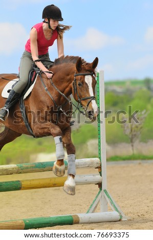 Teen-girl riding a horse - stock photo