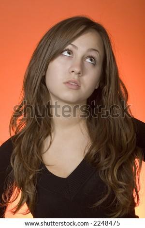teen girl rolling her eyes - stock photo