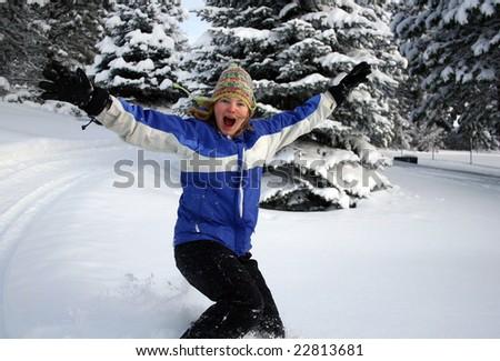 Teen girl running through the snow - stock photo