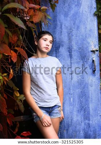 teen girl sad portrait on the autumn fall background - stock photo