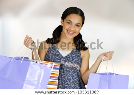 Teen girl shopping with bags on white background