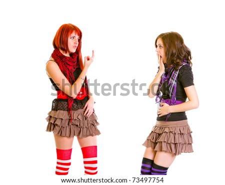 Teen girl showing middle finger her amazed girlfriend isolated on white - stock photo