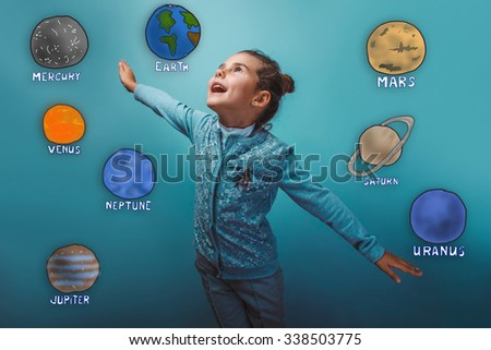Teen girl shows a happy flight of planets in the solar system astronomy - stock photo