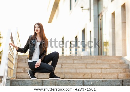 Teen girl sit on the stairs - stock photo