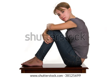 Teen girl sitting on a stool