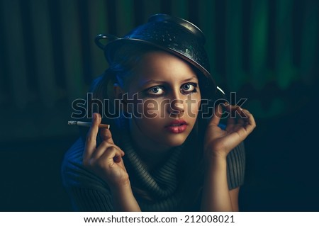 Teen girl smoker, strange creature from a dark fairytale - stock photo
