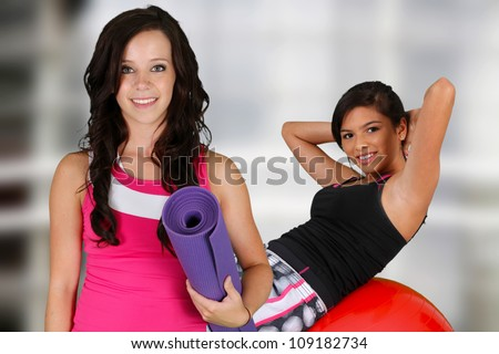Teen girl standing with her yoga mat at the gym
