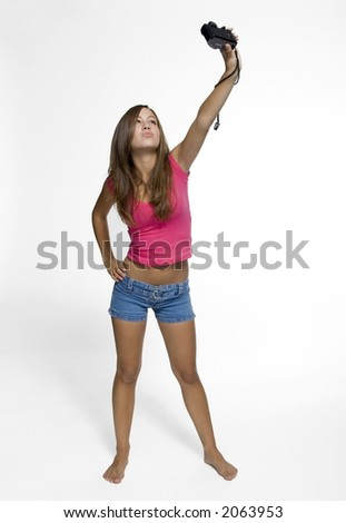 teen girl taking a picture of herself - stock photo