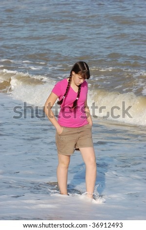 Teen girl walking on the beach . Near Odessa,Ukraine