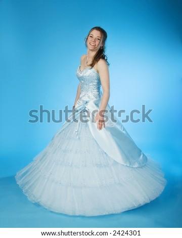 teen girl wearing blue prom dress - stock photo
