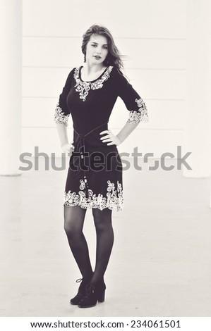 teen girl wearing dress is posing - stock photo