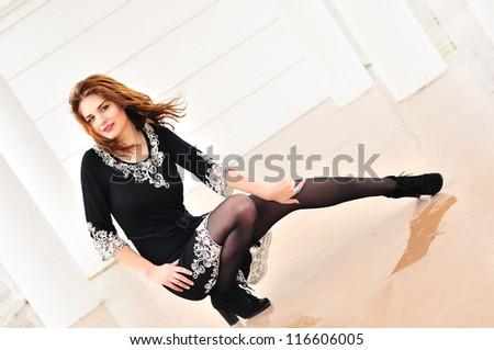 teen girl wearing dress posing - stock photo