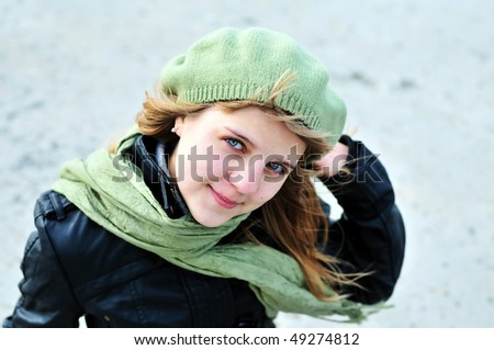 teen girl wearing green beret and scarf - stock photo