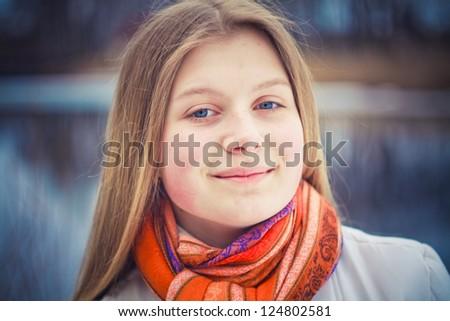 teen girl wearing orange scarf in windy day - stock photo