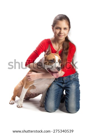 Teen girl with a dog breed Amstaff - stock photo