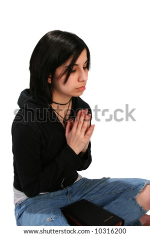 Teen girl with Bible Praying on Isolated Background