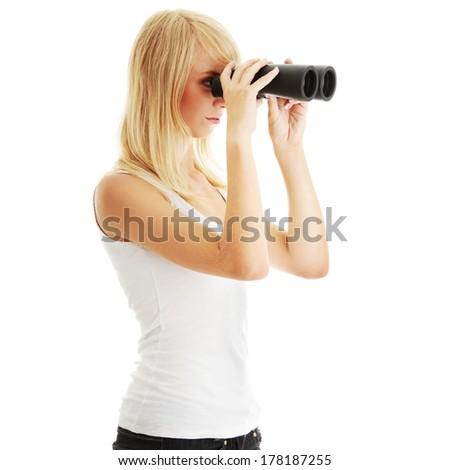Teen girl with binoculars, isolated on white - stock photo