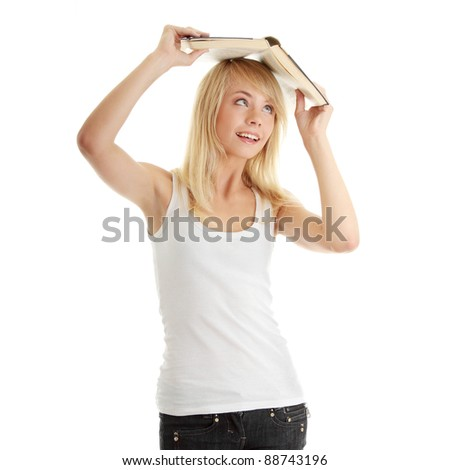 Teen girl with book over her head, isolated on white
