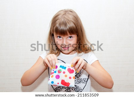 teen girl with colored candy purse searching something