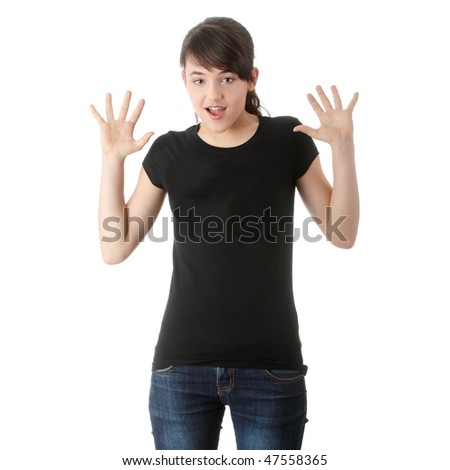 Teen girl with hands up portrait, over white background - stock photo