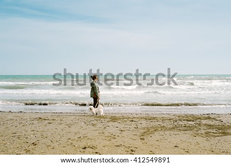 Teen girl with her dog on the beach