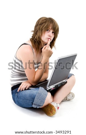 Teen girl with laptop on white background